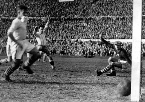 Argentina's Guillermo Stabile slots the ball past American goalkeeper Jim Douglas