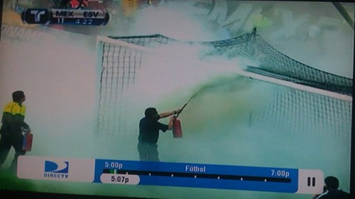 A bee swarm in El Salvador's goal at the Azteca is extinguished. Mexico went on to win the game and qualify for World Cup 2010.
