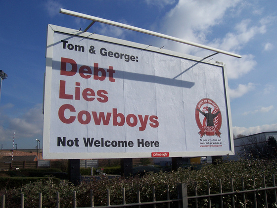 Debt Lies Cowboys billboard