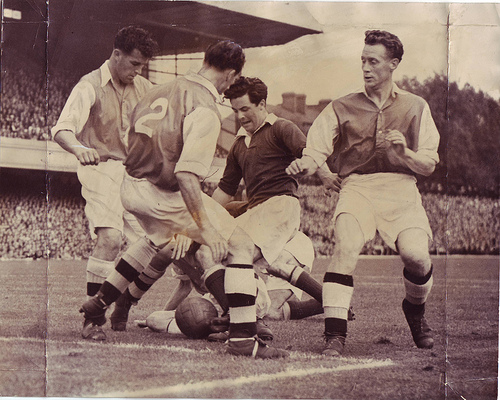 Arsenal v MU 28th August 1948. Johnny Morris battles against Arsenal players Compton, Smith, McCaulay on the ground mixed in amongst the legs is Barnes of Arsenal and Jack Rowley of United. United won 1-0 in front of 62,000.