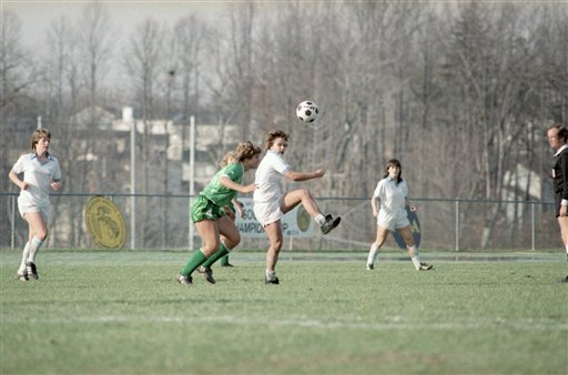 George Mason University's forward Chris Tomek, of Wheaton, Ill., 4, defends against a kick by University of North Carolina's midfielder Marcia McDermott, of McLean, Va., during NCAA Women's Soccer Championships at George Mason University in Fairfax on Sunday, Nov. 24, 1985. George Mason won the tournament 2-0. (AP Photo/Tom Reed)